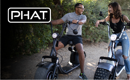 Phat Scooters Electrify your adventure. Photo of a male and female both sitting on a two-wheeled scooters