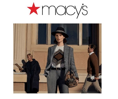 Macy's - women wearing grey suit with hat and bag with two men standing in background