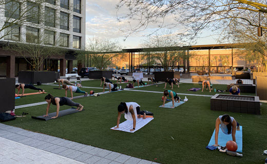 outdoor group fitness class on yoga mats