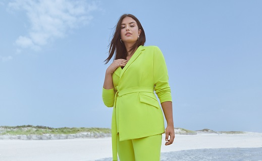 Girl at the beach in lime green suit