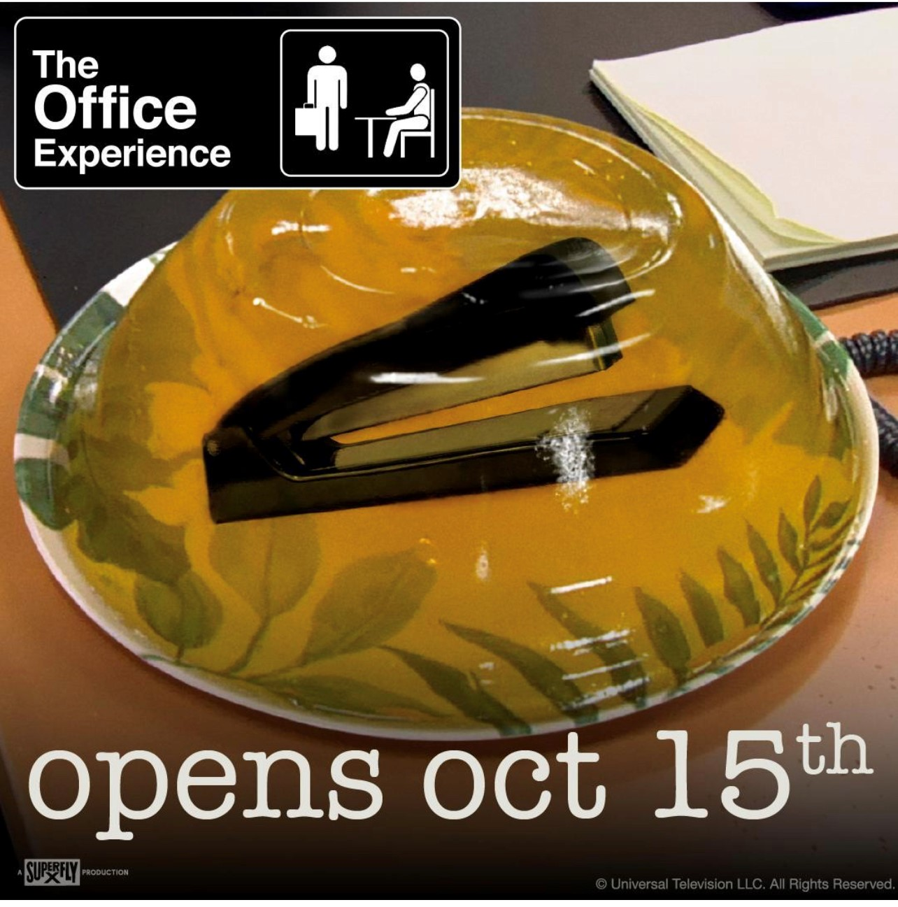 Yellow Jello mold on a plate with stapler inside from the TV show The Office.
