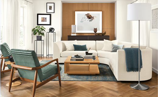Living room with two chairs and a white sectional couch