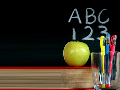 Chalkboard with ABC 123 an apple and a cup of pens
