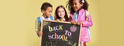 three kids holding a chalkboard that reads Back to School