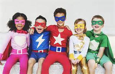 5 children in super hero costumes sitting in a row