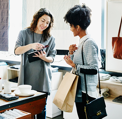 Two women in business transaction.