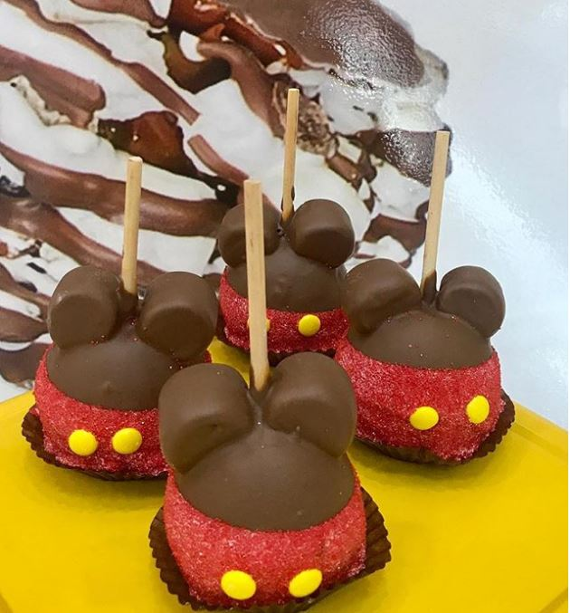 Candy apple shaped like mickey mouse.