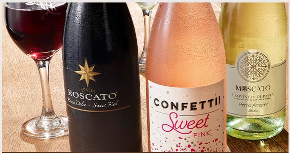 bottles of Roscato, Confetti Sweet Pink and Moscato Wines with a glass of Roscato Wine.