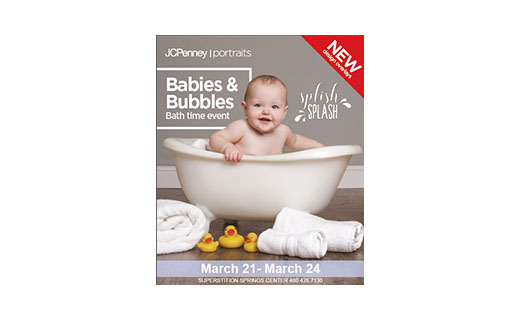 Baby in bathtub with rubber ducks