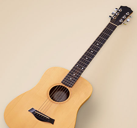 Guitar on beige background