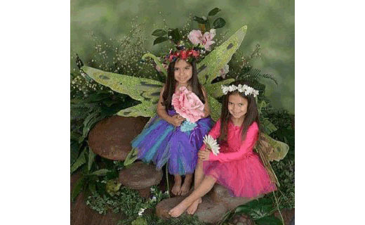 Two girls dressed as fairies.