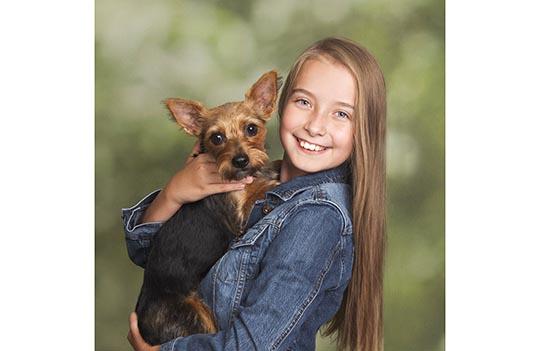 Girl holding her dog.