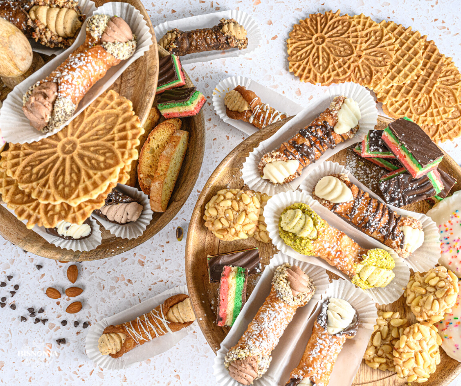 Variety of different Italian desserts from Bisnonna Bakeshop placed on a wooden plate.