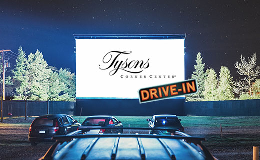 Picture of drive-in movie theatre with cars parked in front