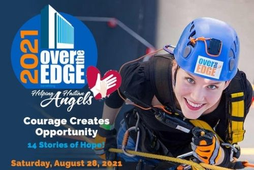 Woman rappelling for the Over The Edge Charity.