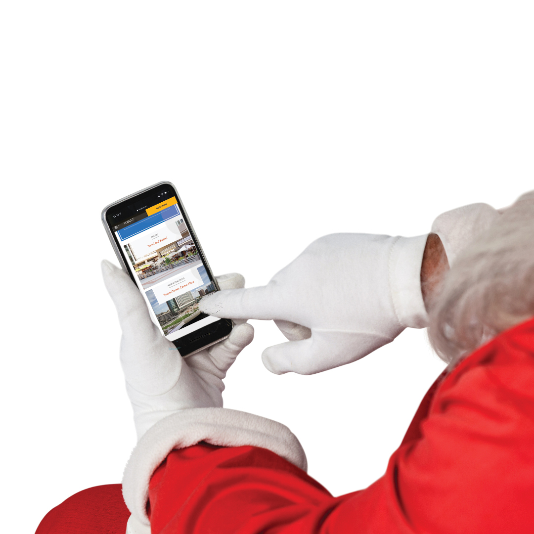 Santa Clause holding a smart phone.