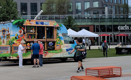 Kona Ice Truck on The Plaza with people walking by