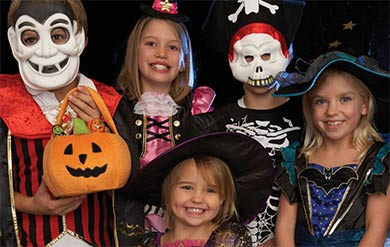 small children dressed in Halloween costumes
