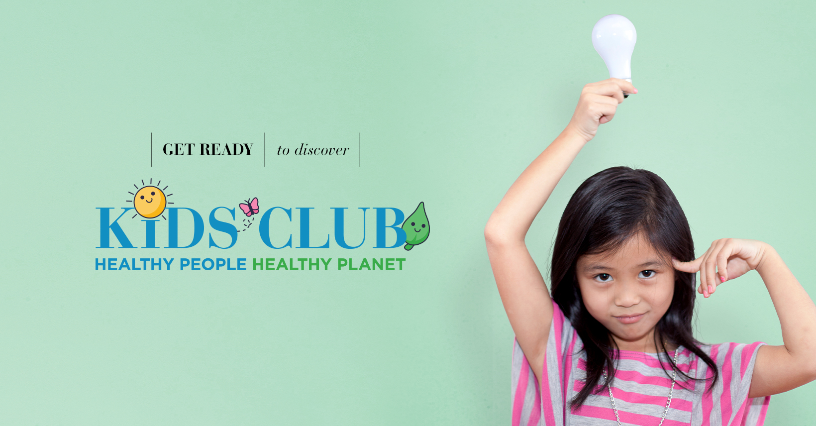young girl holding a light bulb over her head