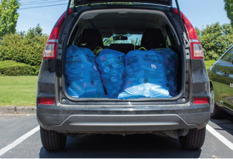 Car with trunk full of blue bags