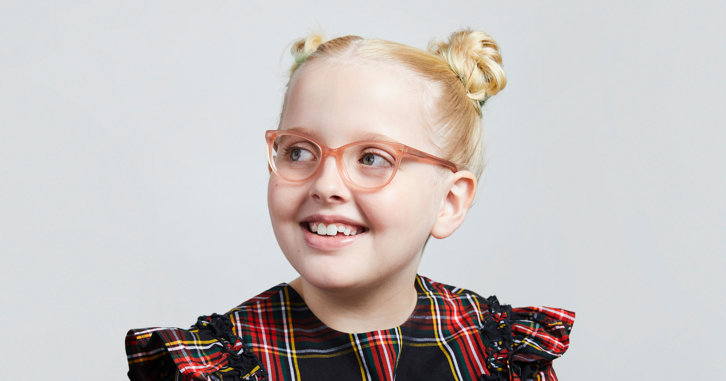 Young girl wearing Warby Parker's kids' collection frames