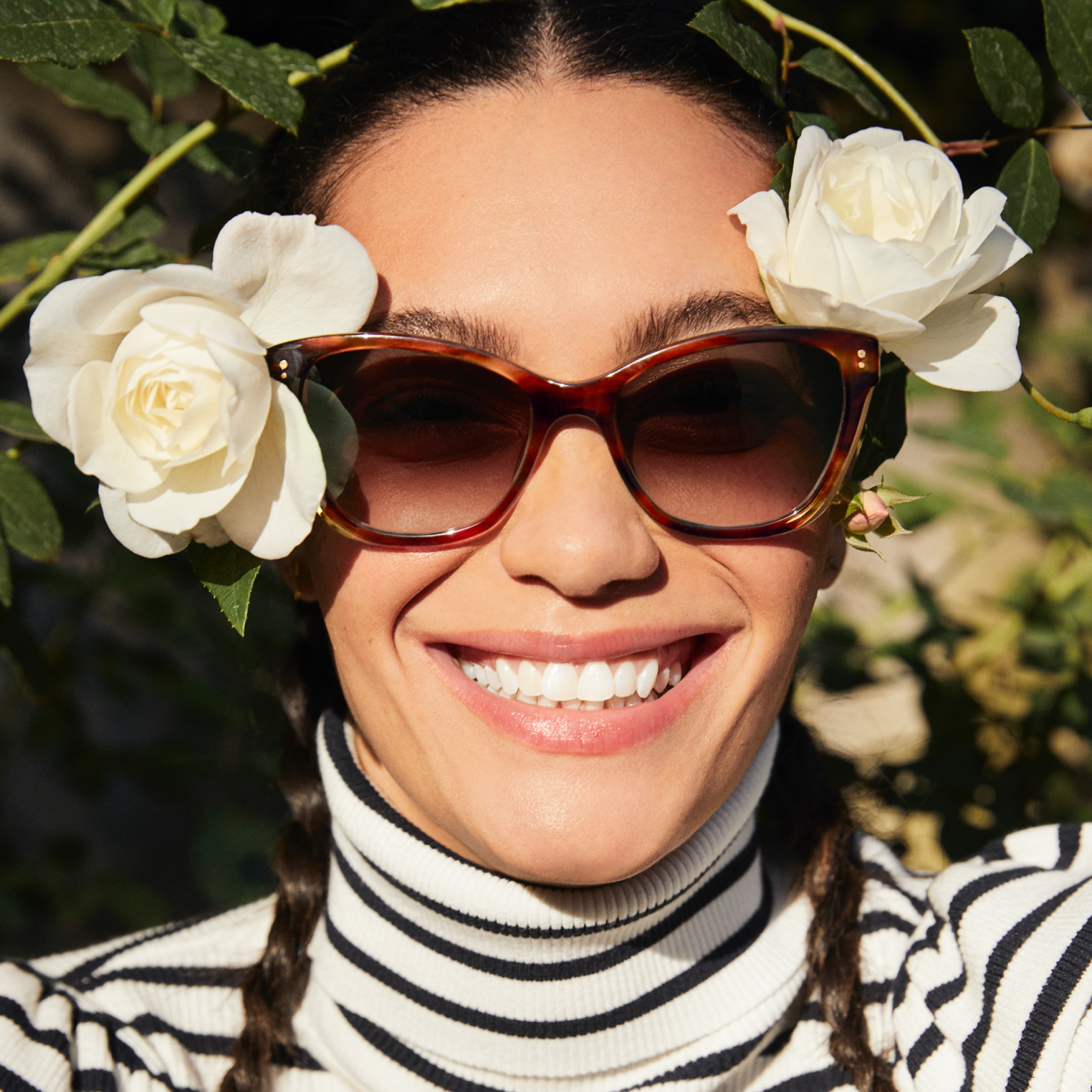Woman wearing Warby Parker sunglasses