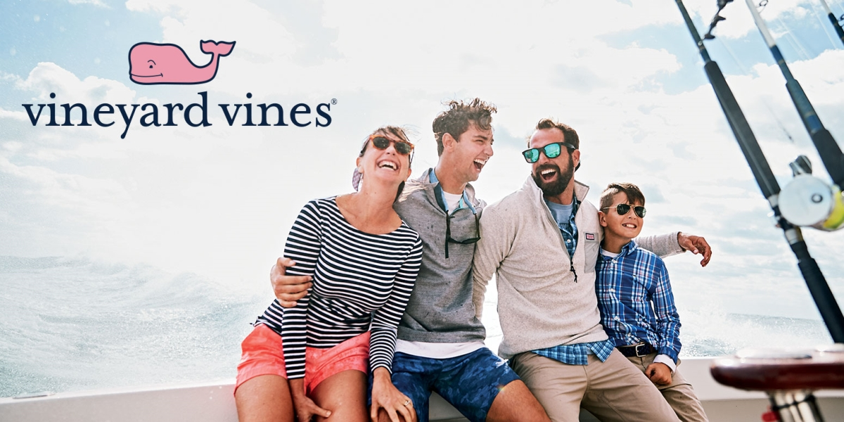 Image of a family on a boat wearing Vineyard Vines Art apparel