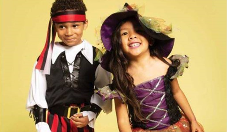 young boy and girl in halloween costumes