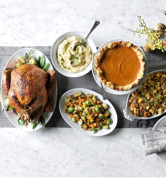 Image of Thanksgiving turkey & side dishes