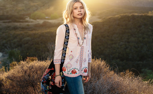 Image of blond woman outdoors wearing a Johnny Was bohemian shirt