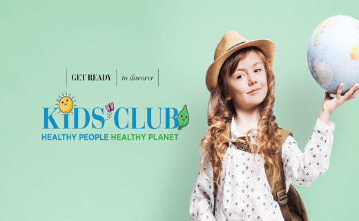 Young girl holding a globe promoting virtual kids club