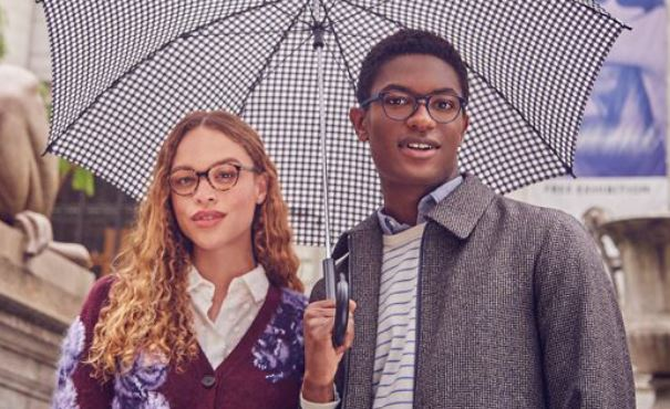 Image of young man and woman wearing Warby Parker glasses