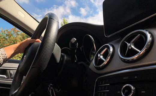steering wheel on the interior of a car.