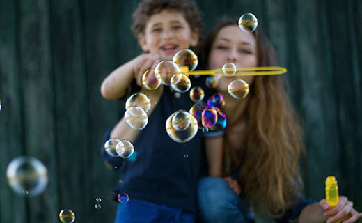 mom and son blowing bubbles