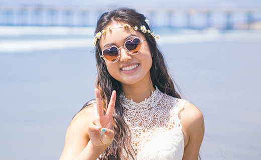 girl wearing heart shaped shades & smiling
