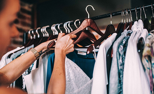 Woman looking through clothes on a rack