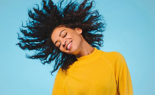 woman smiling with hair flip