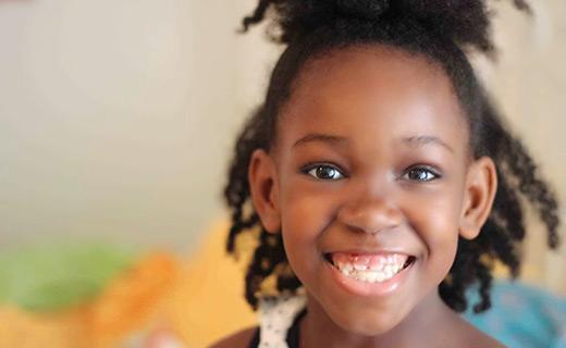 Little girl smiling really big
