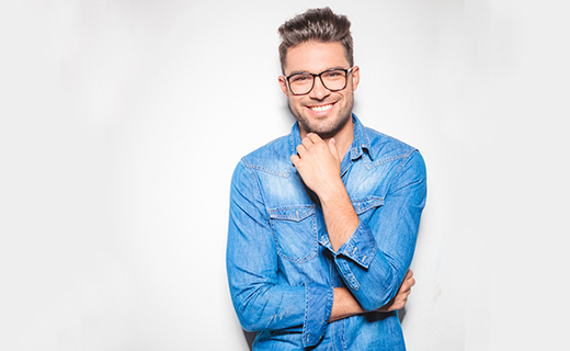 man wearing glasses and smiling