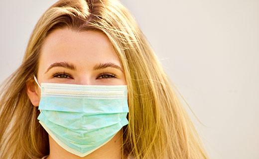 Blond woman wearing a mask