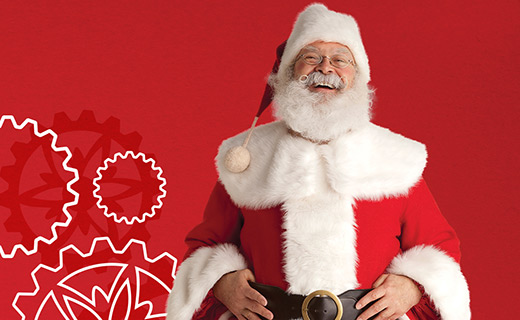 Santa in front of a red background with a gear design
