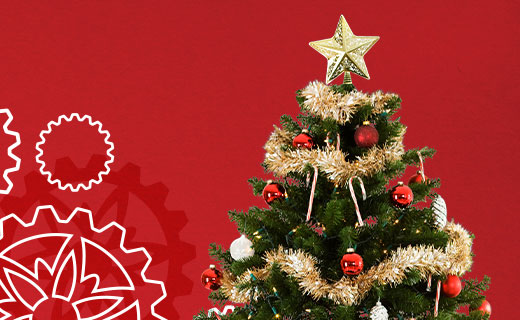 Decorated Christmas tree against a red background.