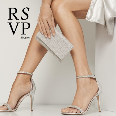 Copy: RSVP Season.  Legs from the knees down wearing strappy high heels and matching handbag