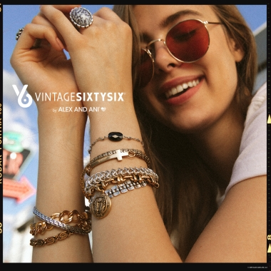 Copy: VintageSixtySix by Alex and Ani logo. Woman wearing sunglasses, eyes closed, smiling arms showing - wearing a collection of various styles and colors of bracelets along with two rings.