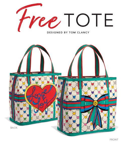 Copy: Free Tote designed by Tom Clancy.  Shown two multi color totes with hearts one with bow on front and other with heart and text Love & joy.