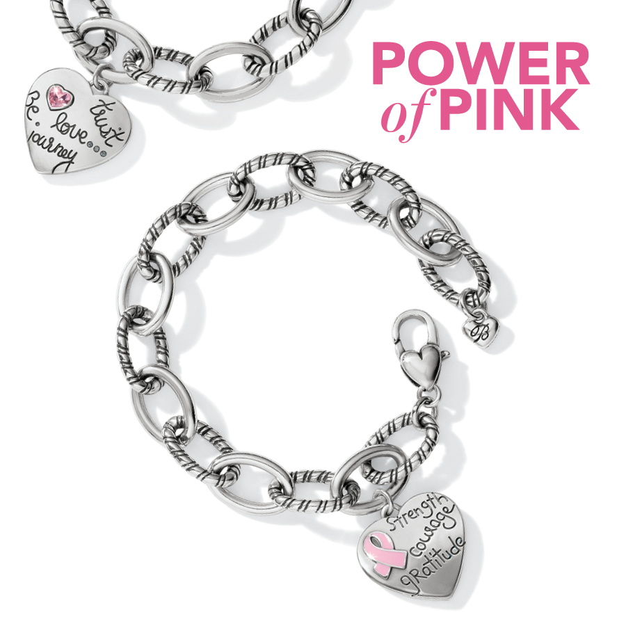 Two limited edition bracelets shown in silver tone with heart charm with breast cancer ribbon, strength, courage and gratitude on one, the other with a pink gemstone heart and trust, Be love, journey. Copy: Power of Pink