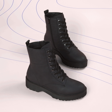 Black lace up boots shown