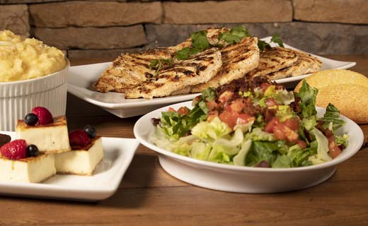 Shown: family meal salad, chicken entrée, side, bread and dessert