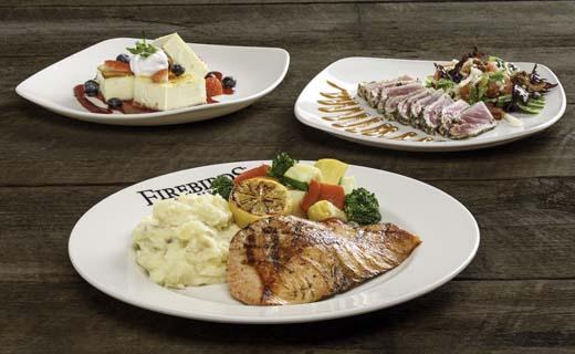 Grilled Salmon, Seared Ahi Tuna and Creme Brulee Cheesecake on white plates.