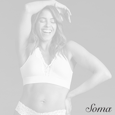 Soma logo. Image woman wearing bra and underwear smiling, standing with hand on hip and other arm over her head.